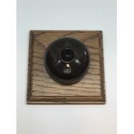Single 2 way Bakelite switch on a square oak pattress