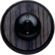 Single 2 way Bakelite switch on circular pattress