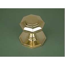 Polished cast brass octagonal door knob.